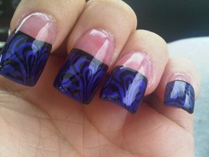 swirl french image in black over purple blue tips on acrylics