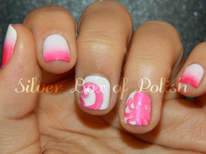 Pink and white nails with gradients and stamping.