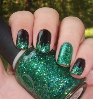 Shiny black with ORLY Mermaid Tale glitter gradient and an accent nail!