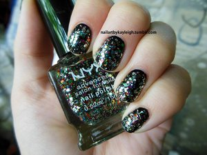 Black polish (Essence one, forget the name!) with my new NYX Polish which I believe is called something boring like Multi-Coloured Glitter lol... cute look though! Colourful AND dark!
