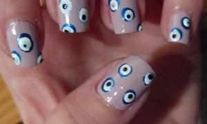 evil eye nail art http://beautybesties.wordpress.com/2011/09/21/diy-evil-eye-nail-art/