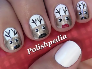 I love Christmas and this design is one way of sharing the spirit of it!  Watch My Video Tutorial @ http://polishpedia.com/reindeer-christmas-nail-art.html