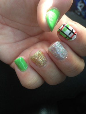 My girl did these nails for me for today, plaid kilt style with green and white and glitters.