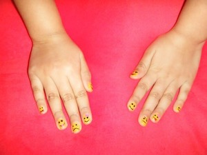 Happy Nails! Modeled by my daughter :)