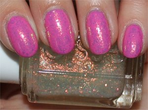 See more swatches & my review here: http://www.swatchandlearn.com/essie-shine-of-the-times-swatches-review-layered-over-opi-if-you-moust-you-moust/