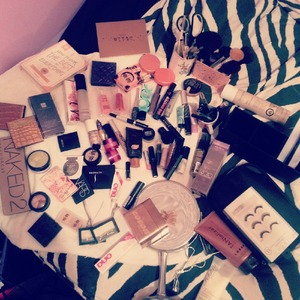 Cleaning off my makeup vanity, brushes, and cosmetics.