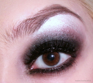 Add depth to an all-black smokey eye with a little shimmer!