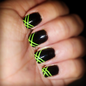 this cute style was made with black and green polish and striping tape