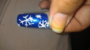 WINTER INSPIRED NAILS BLUE BACKGROUND WITH A FEW SNOWFLAKES