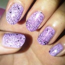 Lavender polish with purple glitter.