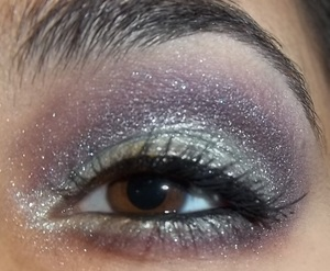 Purple, green, and a lot of sparkles. Loosely based off of The Little Mermaid