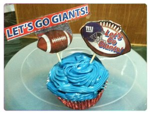 The Super Bowl cupcakes I made. Used toothpicks & newspaper clipping for the football logos. Go Giants!