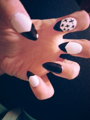 blk and white with blk crosses hubby says penguin nails lol...........