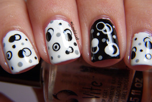More dotting! Black and white molecules! :D http://thepolishwell.blogspot.com/2012/02/nail-ideas-black-and-white-molecules.html