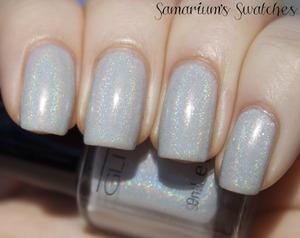 Glitter Gal Light as a Feather  http://samariums-swatches.blogspot.com/2011/12/glitter-gal-light-as-feather-suede.html