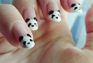 This took me so long, but it's just a few simple panda bears :) I should get some nail art tools, toothpicks aren't the best solution :/ :D