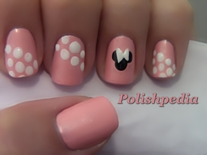 This is my very first attempt to do a design based off of a disney character.  I enjoyed the challenge and love how it turned out.  Watch The Tutorial Video @ http://www.polishpedia.com/minnie-mouse-nail-art.html