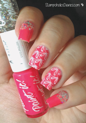 http://stampoholicsdiaries.com/2015/05/25/birthday-nails-with-models-own-essence-and-cicisisi/