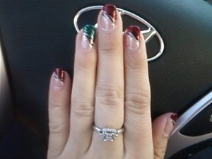 not the best pic. Red and green glitter tips with zebraish black lines