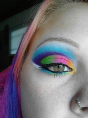 I seen Clarissa V's version of this on makeupbee and had to recreate it, i left out a little bit of blue but I am pleased with my outcome :) I used Sugarpill tako, poison plum, flamepoint, and buttercupcake along with coastal scents vibrant hot pots in blue, green and pink!