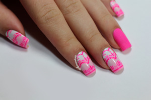 More info + tutorial here: http://www.lacquerstyle.com/2013/11/pink-lace-nails-for-breast-cancer.html