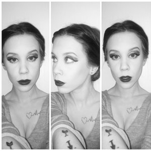 A dark lip with a bright pop of emerald on the lids for a wintery look. Seen in Black n White. ??