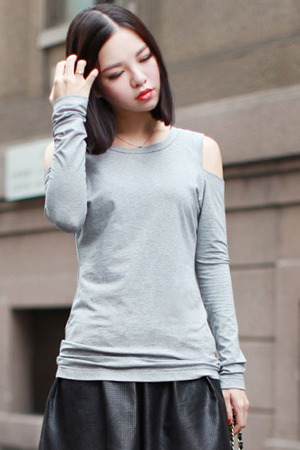 Grey blouse, featuring round neck, cut-out design over the shoulders, slim fit, soft touch fabric. Goes great with your black skirt and black short boots when attending your friend's party.