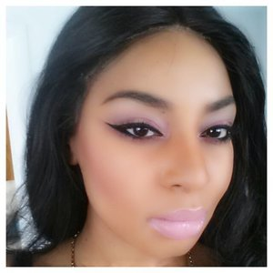 Pink/purple smokey eye with a strong wing
