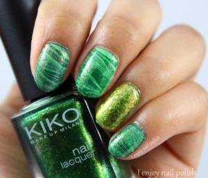 🍀🍀Happy Saint Patrick's Day!🍀🍀 I hope you're having a great one! I decided to do a simple green stripe water marble design, & gold accent finger.   The nail polishes I used for this mani were: Julep Lucky, Pop Beauty Raw, Essence The Green & The Grunge, Sinful Colors 24 Karat, Sinful Colors Cash Game, Kiko 533, & Zoya Maria Luisa.
