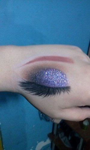 Sorry about the bad quality! Purple glitter makeup inspiration!
