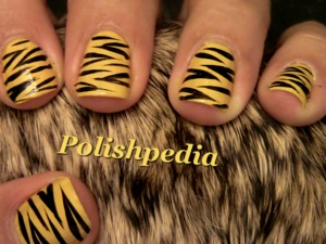 I loved doing these tiger nails.  They are really easy to do and will bring positive attention.  Get ready for some compliments!  Watch Tutorial @ http://www.polishpedia.com/tiger-nails.html