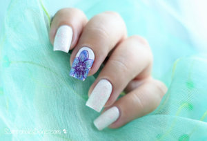 http://stampoholicsdiaries.com/2015/12/06/flower-nails-with-essence-uberchick-beauty-and-konad/