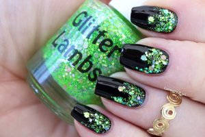 "This glitter topper is called ""Lime Green Eyeshadow"" and is worn by @LacqueredLori. She did a gorgeous gradient with it over black. This really just pops off the nail! STUNNING!"