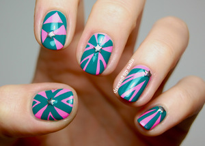 I did these freehand with a striper brush using Color Club Flamingo and Wild Cactus from the spring 2013 collection plus star studs from Born Pretty Store!  http://www.dressedupnails.com/2013/03/pink-and-green-geometric-nail-art-with.html