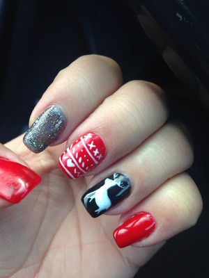 Holiday Christmas nails with sweater design and reindeer in red and black