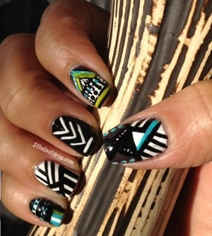 Tribal nails http://2thelastdrop.com/2012/01/17/tribal-nails-day-16-of-31-day-nail-challenge/