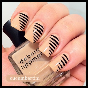 Black stripes on nude nailpolish by Deborah Lippmann called NAKED