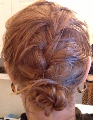 French braided my hair from crown to ends, then used a hair tie to simply gather the hair from the nape of the neck down into a loose bun.
