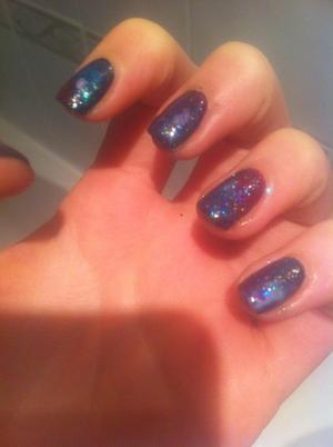 my friend sent me a image of someones nails that looks like these. i loved it so much i had to try it myself! colours i used:OPI- Ski Teal We Drop, Barry M- black, raspberry, mint green & pink iridescent xXx