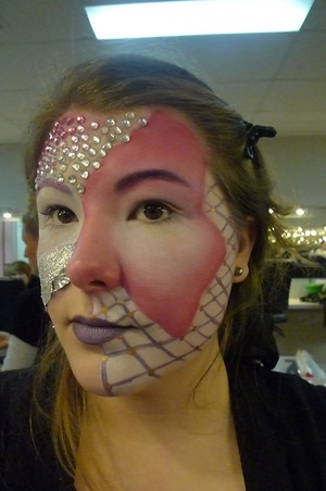 Gradient shading with grease paint and line work plus ombre lips.