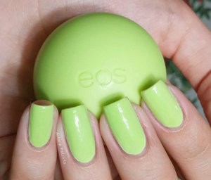 I'm holding an eos smooth sphere in the flavor Honeysuckle Honeydew and this is also a swatch of China Glaze Be More Pacific from the Summer 2014 Off Shore Collection :)