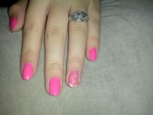 Sally Hansen nails with a polka dot ring finger