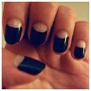 Black & Glow-in-the-Dark half moon manicure