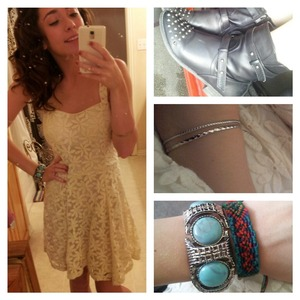 a girly floral dress with black studded leather boots for some edge (:
