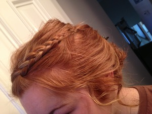 Bangs braided, so is hair. Then once at base it is twisted into a bun. But also all curled.