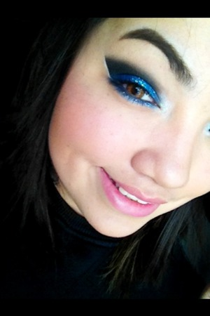 """Last nights look. I used my Urban Decay """"Crave"""" and My Beauty Mark blue from their theatrical palette, the inner corner is a matte white from Sephora. I used a blue and white glitter from Sally's."""