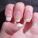 French Manicure with an golden chain.