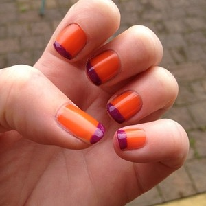 Milani awesome orange base colour with Barry M bright purple french tip