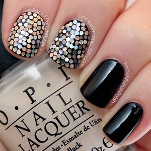 I placed each piece of glitter individually on my nail with a dotting tool.  The black polish is Wet n Wild Wild Shine Black Creme.  Tutorial: http://youtu.be/YdME084kWyc  Full Blog Post: http://www.packapunchpolish.com/2013/01/black-and-silver-glitter-placement-nail.html
