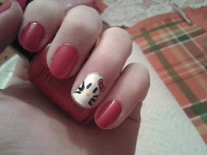 Just a simple Hello Kitty nail look I did using NYC Big Apple Red, Wet n Wild French White, and Maybelline Fierce n Tangy and Wet n Wild Black Creme for details.